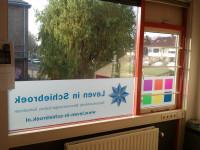 Full colour raamfolie (2), kantoor, logo, huisstijl, van binnenuit